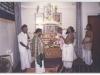 Temple priest honouring panditji at tamil sangam(london)